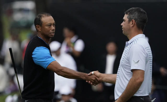 Tiger Woods of the United States, shakes hands with Gary Woodland of the United States on the18th hole after finishiing the third round of the Zozo Championship PGA Tour at the Accordia Golf Narashino country club in Inzai, east of Tokyo, Japan, Sunday, Oct. 27, 2019. (AP Photo/Lee Jin-man)