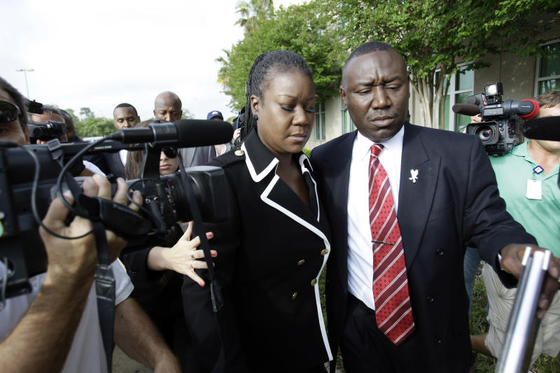 Sybrina Fulton, left, mother of Trayvon Martin and attorney Benjamin Crump, arrive at the Seminole County Criminal Justice Center for a bond hearing for George Zimmerman, the neighborhood watch volunteer charged with murdering Trayvon Martin, Friday, April 20, 2012, in Sanford, Fla. Zimmerman's attorney is asking the Seminole County judge to let Zimmerman post bail at the hearing Friday. (AP Photo/John Raoux)