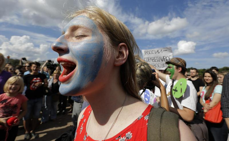 Demonstrators with painted faces chant slogans in support of the Russian punk group Pussy Riot whose members face prison for a stunt against President Vladimir Putin, in St.Petersburg, Russia, Friday, Aug. 17, 2012. Pussy Riot members, two of whom have young children, are charged with hooliganism connected to religious hatred, but the case is widely seen as a warning that authorities will only tolerate opposition under tightly controlled conditions. (AP Photo/Dmitry Lovetsky)