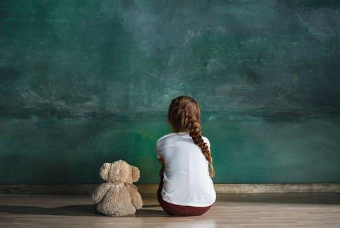 """<span class=""""caption"""">Our study is the first to show that childhood maltreatment, at least in part, causes poorer mental health. </span> <span class=""""attribution""""><a class=""""link rapid-noclick-resp"""" href=""""https://www.shutterstock.com/image-photo/little-autistic-girl-teddy-bear-sitting-1098551924"""" rel=""""nofollow noopener"""" target=""""_blank"""" data-ylk=""""slk:Master1305/ Shutterstock"""">Master1305/ Shutterstock</a></span>"""