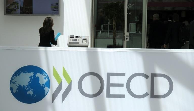 The OECD-brokered deal, which sets a global tax of 15 percent, is aimed at stopping international corporations from slashing tax bills by registering in nations with low rates (AFP/Eric PIERMONT)