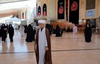 Sheikh Qorban Ali, seen here walking in the Imam Ali shrine in Iraq's central holy shrine city of Najaf, dreams of going home to Afghanistan (AFP/Qassem al-KAABI)