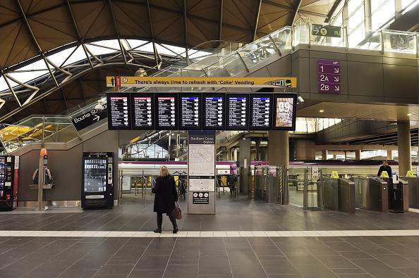 A commuter checks the departure board at a deserted Spencer Street Station in Melbourne.