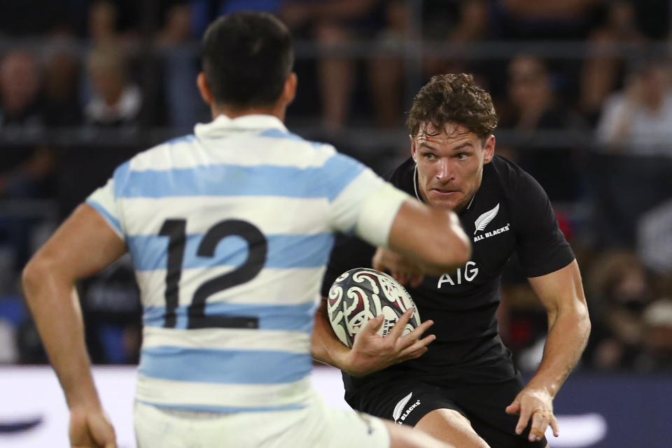 New Zealand's George Bridge, right, looks to get past Argentina's Jeronimo de la Fuente during their Rugby Championship match on Sunday, Sept. 12, 2021, on the Gold Coast, Australia. (AP Photo/Tertius Pickard)