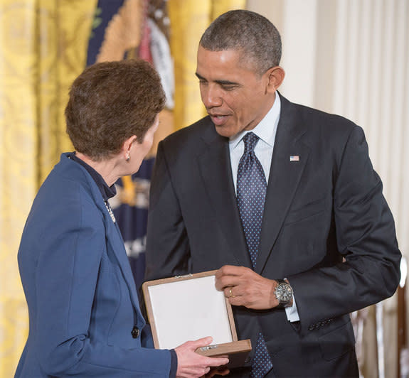 Tam O'Shaughnessy, Sally Ride's life partner and chair of Sally Ride Science, is seen with President Barack Obama accepting the Presidential Medal of Freedom on behalf of Ride, Wednesday, Nov. 20, 2013 at the White House.