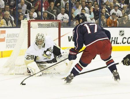Columbus Blue Jackets center Brandon Dubinsky (17) controls the puck against Pittsburgh Penguins goalie Marc-Andre Fleury (29) in game six of the first round of the 2014 Stanley Cup Playoffs at Nationwide Arena. April 28, 2014; Columbus, OH, USA; Greg Bartram-USA TODAY Sports