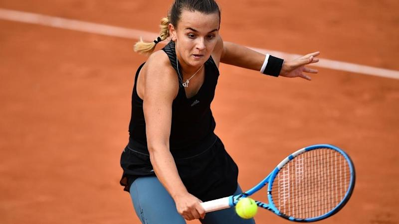 France's 19-year old Burel rallies the country's spirits at the French Open