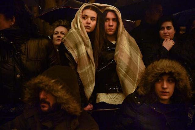 "<p>Devotees protect themselves from the rain during a procession of the ""Santa Veracruz"" brotherhood, during the Holy Week in Calahorra, northern Spain, Wednesday, March 28, 2018. (Photo: Alvaro Barrientos/AP) </p>"