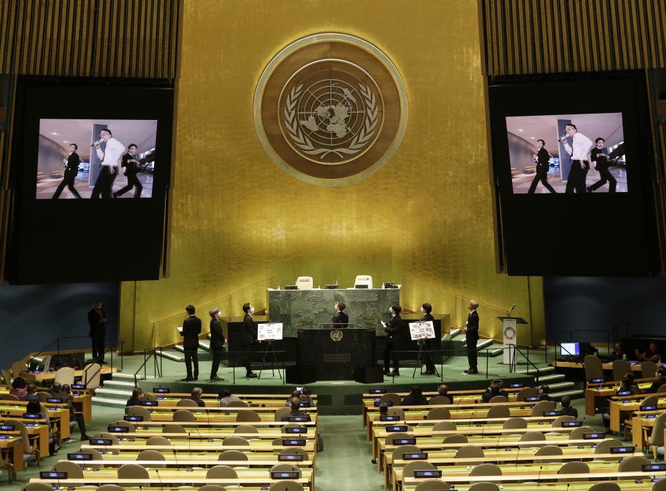 Members of South Korean K-pop band BTS watch a music video on the General Assembly Hall monitors during a meeting on Sustainable Development Goals at the 76th session of the U.N. General Assembly at U.N. headquarters on Monday, Sept. 20, 2021. (John Angelillo/Pool Photo via AP)