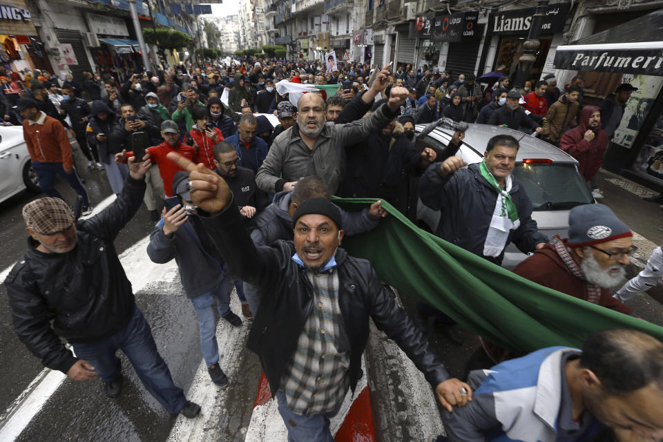 Algerians demonstrate in Algiers to mark the second anniversary of the Hirak movement, Monday Feb. 22, 2021. February 22 marks the second anniversary of Hirak, the popular movement that led to the fall of Algerian President Abdelaziz Bouteflika. (AP Photo/Anis Belghoul)