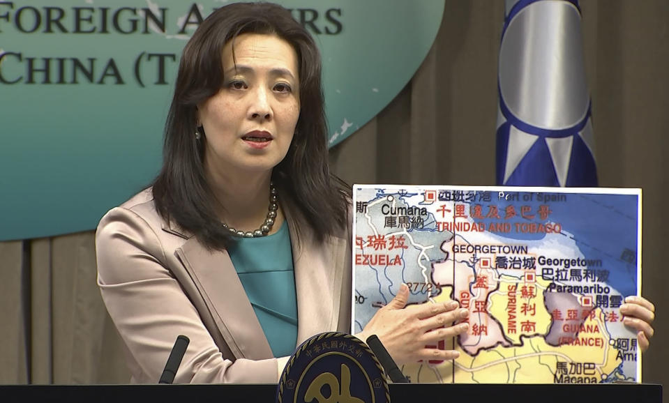 In this image made from video, Taiwan's Ministry of Foreign Affairs spokesperson Joanne Ou points at a map of Guyana at a weekly press conference, Thursday, Feb. 4, 2021, in Taipei, Taiwan. Taiwan has established a trade office in the South American country of Guyana, a diplomatic win for the island which has continued to lose allies in an aggressive poaching campaign from China in recent years. (AP Photo)