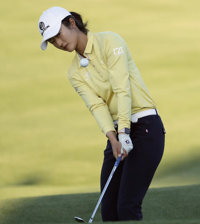 Yu Liu chips onto the 18th green during the final round of the Founders Cup LPGA golf tournament Sunday, March 24, 2019, in Phoenix. (AP Photo/Matt York)