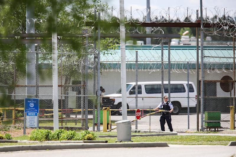 A guard at the entrance to the Lee Correctional Institution in Bishopville, South Carolina, where seven inmates were killed and 17 injured in clashes (AFP Photo/Logan Cyrus)