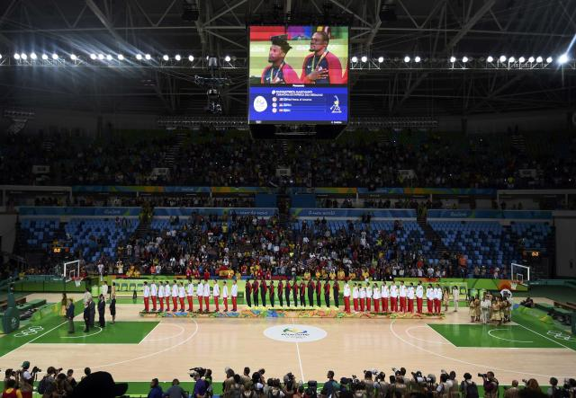 2016 Rio Olympics - Basketball - Final - Men's Victory Ceremony - Carioca Arena 1 - Rio de Janeiro, Brazil - 21/8/2016. Team Serbia, Team USA and Team Spain stand as U.S. national anthem is played. REUTERS/Dylan Martinez FOR EDITORIAL USE ONLY. NOT FOR SALE FOR MARKETING OR ADVERTISING CAMPAIGNS.