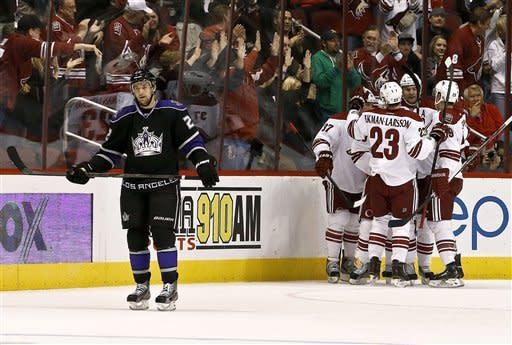 Los Angeles Kings' Trevor Lewis (22) skates away as Phoenix Coyotes' Oliver Ekman-Larsson (23), of Sweden; Raffi Torres (37); Michael Stone, right; and Martin Hanzal, second from right, of the Czech Republic, celebrate a goal by Mikkel Boedker during the first period of an NHL hockey game Tuesday, March 12, 2013, in Glendale, Ariz. (AP Photo/Ross D. Franklin)