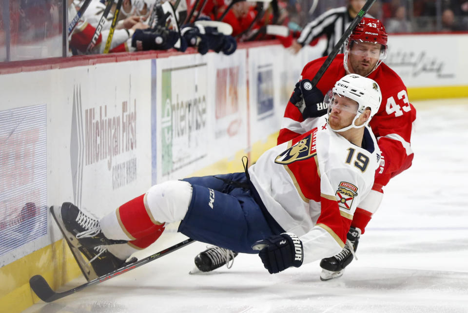 Detroit Red Wings left wing Darren Helm (43) checks Florida Panthers defenseman Mike Matheson (19) during the third period of an NHL hockey game Saturday, Jan. 18, 2020, in Detroit. (AP Photo/Paul Sancya)