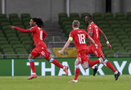 Luxembourg's Gerson Rodrigues, left, celebrates scoring their side's first goal of the game during their World Cup 2022 group A qualifying soccer match against Republic of Ireland at the Aviva Stadium, Dublin, Saturday, March 27, 2021. (Brian Lawless/PA via AP)