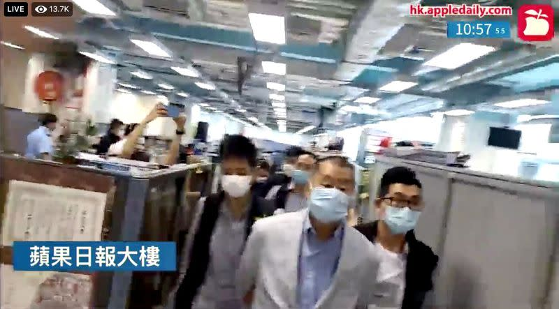 Media tycoon Jimmy Lai is detained under national security law after Hong Kong police raid Apple Daily office in Hong Kong