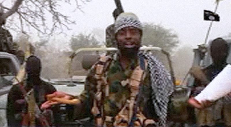 This screen grab image taken on December 29, 2016 from a video released on Youtube by Islamist group Boko Haram shows Boko Haram leader Abubakar Shekau making a statement at an undisclosed location