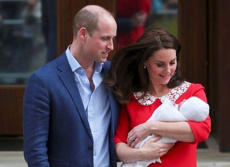 Prince Louis christened while beaming royal family look on