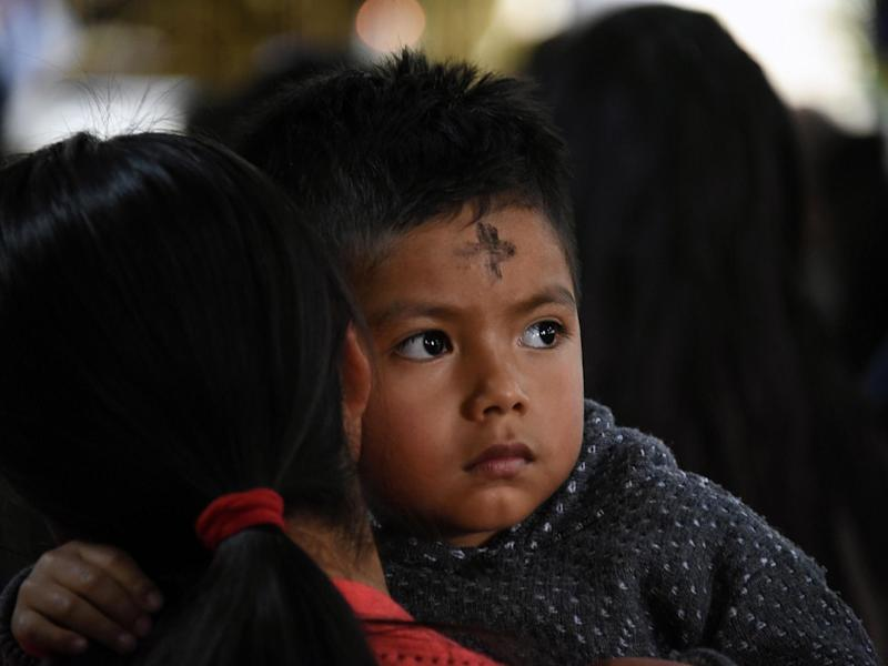 Catholic parishioners participate in the traditional Ash Wednesday ceremony at San Juan Sacatepequez's church, 30 kilometres northwest of Guatemala City on 6 March 2019: JOHAN ORDONEZ/AFP via Getty Images