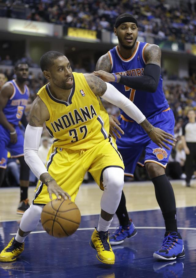 Indiana Pacers center Ian Mahinmi, left, cuts in front of New York Knicks forward Carmelo Anthony during the second half of an NBA basketball game in Indianapolis, Thursday, Jan. 16, 2014. The Pacers defeated the Knicks 117-89. (AP Photo/Michael Conroy)