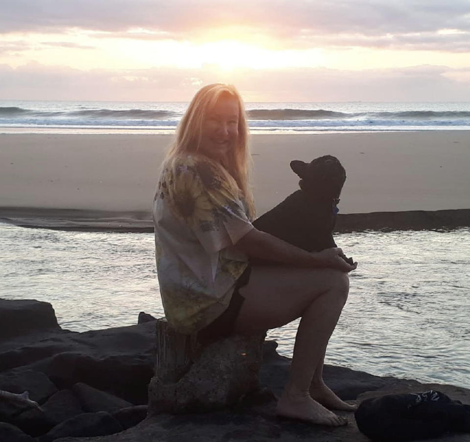 Ms Johnson at Currimundi Lake with her dog. Source: Supplied