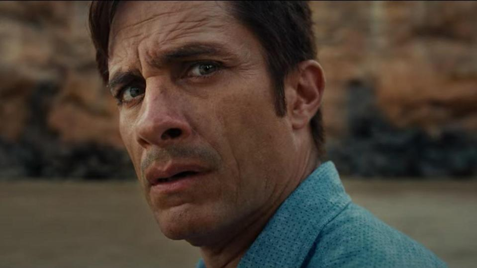 Gael Garcia Bernal's noticeably wizened face turns apprehensively toward the camera at the horror he is to find in the movie Old.