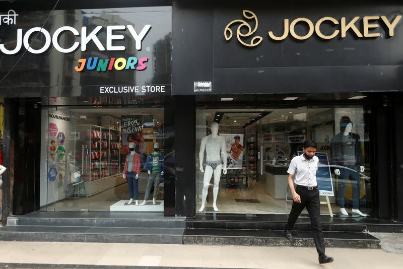 FILE PHOTO: A man walks out of a Jockey outlet in Mumbai