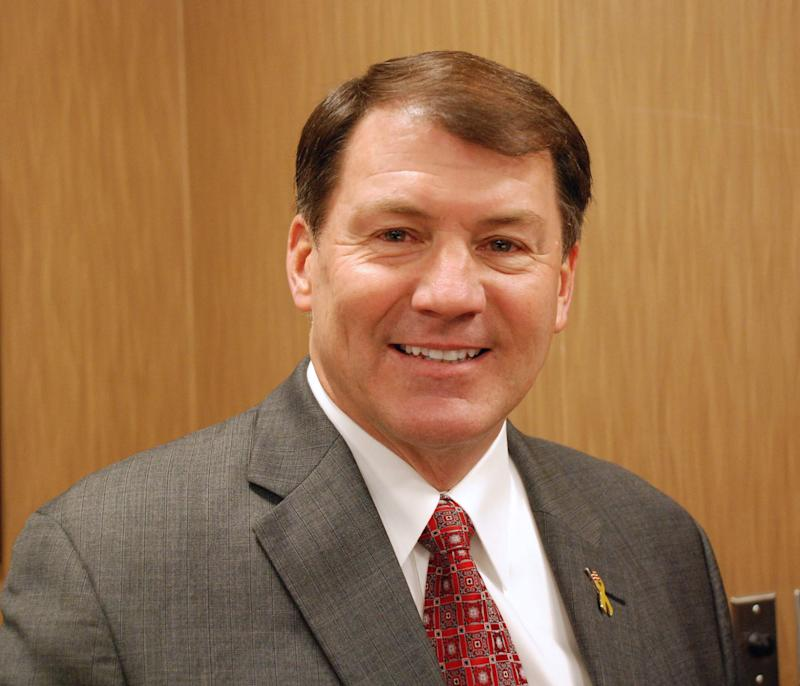 Former South Dakota Gov. Mike Rounds smiles Thursday, Nov. 29, 2012, in Pierre, S.D., at a press conference where he announced he will run for the U.S. Senate in 2012.  (AP Photo/Chet Brokaw)