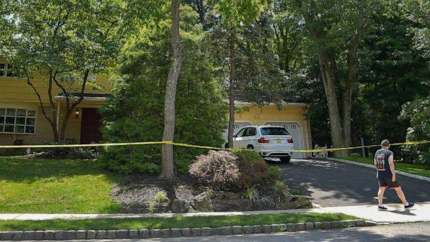 PHOTO: A man walks past the home of U.S. District Judge Esther Salas on July 20, 2020, in North Brunswick, N.J., after a man shot and killed Salas' son, Daniel Anderl, and injured her husband, Mark Anderl. (Michael Loccisano/Getty Images)