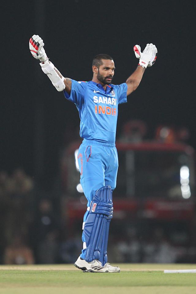 Shikhar Dhawan celebrates century  during the sixth Star Sports Series One Day International (ODI) between India and Australia held at the VIDARBHA CRICKET ASSOCIATION STADIUM, NAGPUR on the 30th October 2013