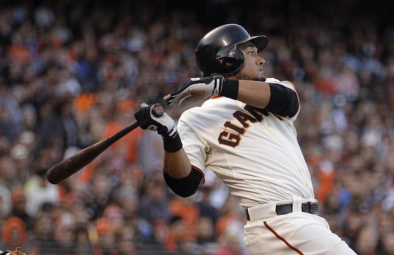 FILE - This July 14, 2012 file photo shows San Francisco Giants' Melky Cabrera swinging for an RBI single off Houston Astros' Lucas Harrell in the fifth inning of a baseball game in San Francisco. Major League Baseball appears unlikely to interfere if Melky Cabrera wins the NL batting title while serving his 50-game suspension for a positive drug test. (AP Photo/Ben Margot, File)