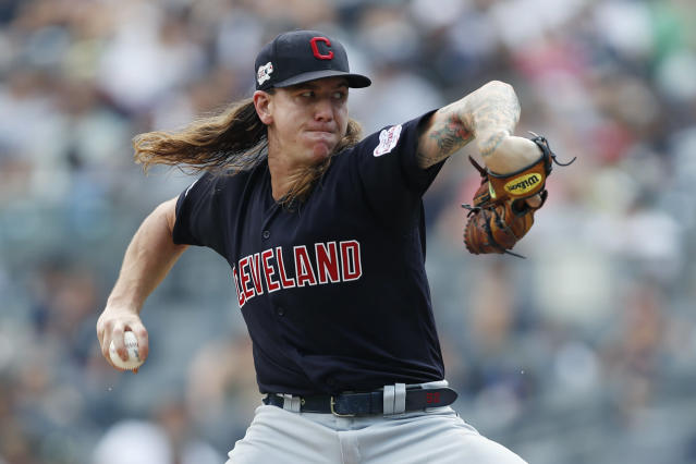 Cleveland Indians' starting pitcher Mike Clevinger winds up during the first inning of a baseball game against the New York Yankees, Sunday, Aug. 18, 2019, in New York. (AP Photo/Kathy Willens)