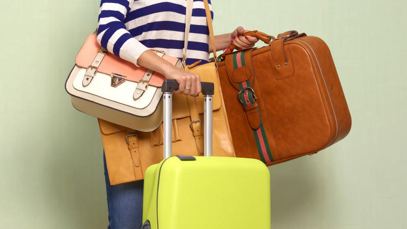 Female traveller with a lot of baggage, excess luggage.