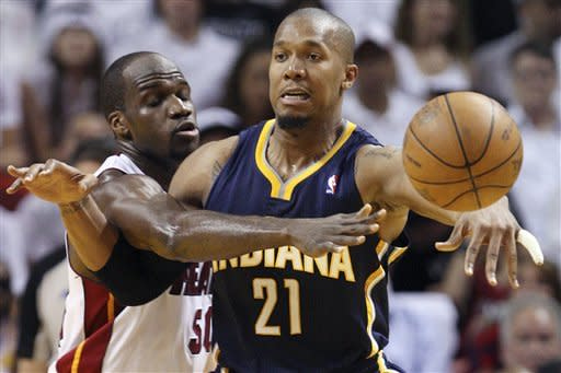 Indiana Pacers forward David West (21) passes as he is guarded by Miami Heat center Joel Anthony during the second half of Game 1 in an NBA basketball Eastern Conference semifinal playoff series, Sunday, April 13, 2012, in Miami. The Heat won 95-86. (AP Photo/Wilfredo Lee)