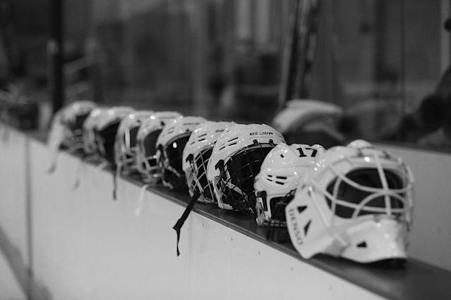BROOKLYN, NY – OCTOBER 25: (EDITORS NOTE: Image has been converted to black and white.) helmets belonging to the New York Riveters of the National Womens Hockey League are placed on the boards prior to the game against the Connecticut Whale at the Aviator Sports and Event Center on October 25, 2015 in Brooklyn borough of New York City. (Photo by Bruce Bennett/Getty Images)