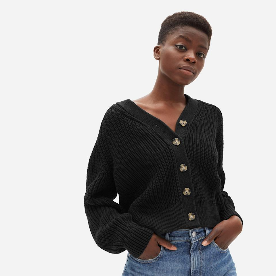 """<p><strong>everlane</strong></p><p>everlane.com</p><p><strong>$98.00</strong></p><p><a href=""""https://go.redirectingat.com?id=74968X1596630&url=https%3A%2F%2Fwww.everlane.com%2Fproducts%2Fwomens-texture-ctn-cardigan-black&sref=https%3A%2F%2Fwww.goodhousekeeping.com%2Fholidays%2Fthanksgiving-ideas%2Fg22728910%2Fthanksgiving-outfits%2F"""" rel=""""nofollow noopener"""" target=""""_blank"""" data-ylk=""""slk:Shop Now"""" class=""""link rapid-noclick-resp"""">Shop Now</a></p>"""