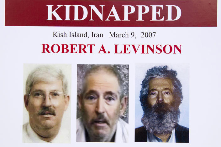 FILE - In this March 6, 2012, file photo, an FBI poster showing a composite image of former FBI agent Robert Levinson, right, of how he would look like now after five years in captivity, and an image, center, taken from the video, released by his kidnappers, and a picture before he was kidnapped, left, displayed during a news conference in Washington. Iran is acknowledging for the first time it has an open case before its Revolutionary Court over the 2007 disappearance of a former FBI agent on an unauthorized CIA mission to the country. In a filing to the United Nations, Iran said the case over Robert Levinson was