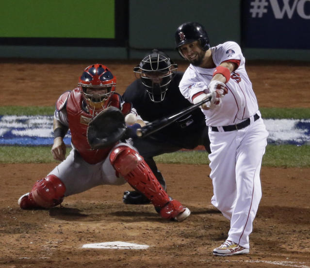 Boston Red Sox's Shane Victorino hits an RBI ingle during the fourth inning of Game 6 of baseball's World Series against the St. Louis Cardinals Wednesday, Oct. 30, 2013, in Boston. (AP Photo/Charlie Riedel)