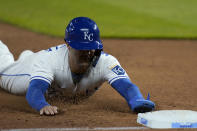 Kansas City Royals Whit Merrifield slides into third base during the third inning of a baseball game against the Los Angeles Angels at Kauffman Stadium in Kansas City, Mo., Tuesday, April 13, 2021. Merrifield was safe with a stolen base on the play. (AP Photo/Orlin Wagner)