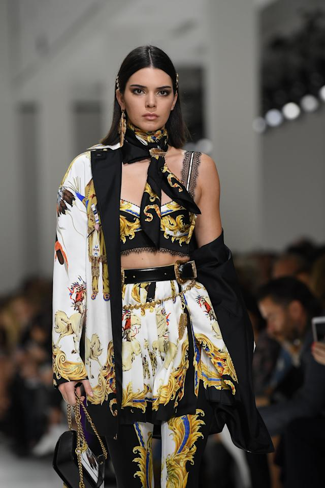 <p>What isn't there to love about this outfit? For the Versace Spring 2018 runway show, Jenner took the catwalk in a printed jacket delicately hanging off her shoulder.</p>