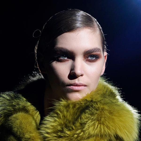 <b>Tom Ford </b><br><br>Models had rusty brown smoky eyes at the show.<br><br>Image © PA