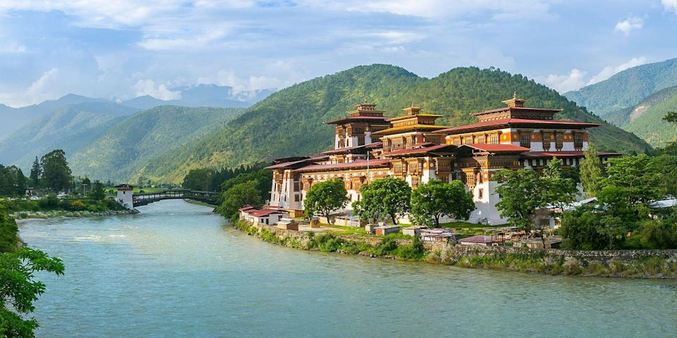 """<p><a href=""""https://www.tripadvisor.com/Tourism-g293844-Bhutan-Vacations.html"""" rel=""""nofollow noopener"""" target=""""_blank"""" data-ylk=""""slk:This Himalayan kingdom"""" class=""""link rapid-noclick-resp"""">This Himalayan kingdom</a>, between India and China, is mysterious and mystical — not to mention one of the most beautiful places in the world. Its mountainous landscape is home to remote villages, Buddhist temples, <em>dzongs</em> (traditional fortress-like structures), and monasteries, such as the Paro Taktsang (Tiger's Nest), built into the rocky cliff in the lush Paro Valley. </p>"""