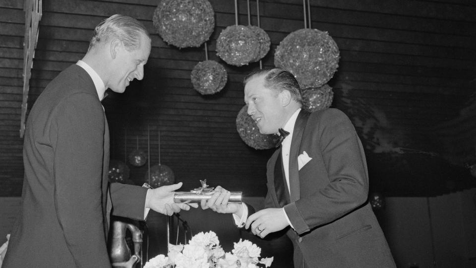 Prince Philip, Duke of Edinburgh, presents an award to Richard Attenborough at the 16th British Academy Film Awards on 8 May, 1963. (Photo by Les Lee/Daily Express/Hulton Archive/Getty Images)
