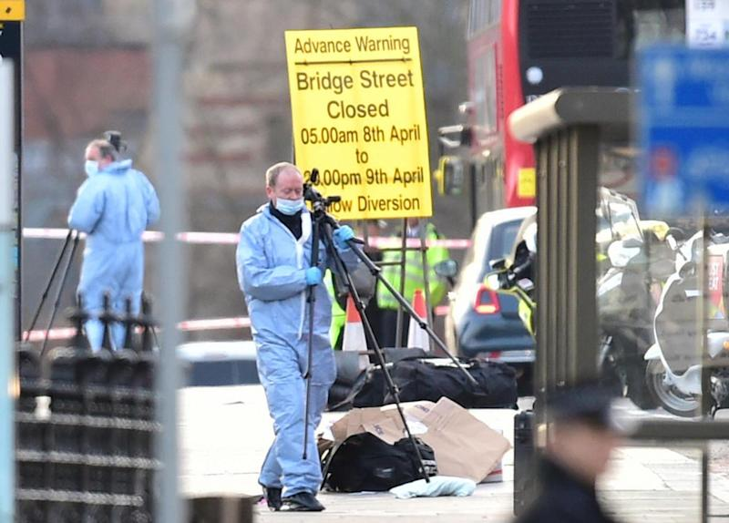 Forensic officers after the attack (PA)