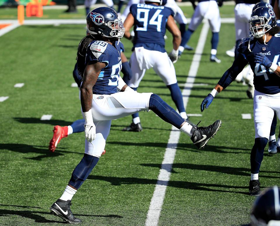 Defensive end Jadeveon Clowney (99) of the Tennessee Titans warms up before the game against the Cincinnati Bengals at Paul Brown Stadium on November 01, 2020 in Cincinnati, Ohio.