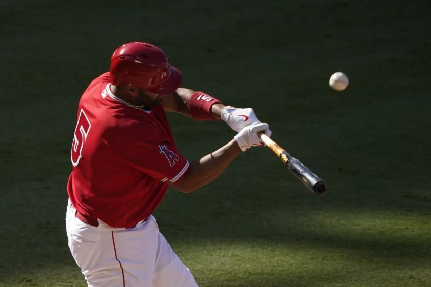 Los Angeles Angels first baseman Albert Pujols bats during an intrasquad game at baseball practice at Angel Stadium on Friday, July 10, 2020, in Anaheim, Calif. (AP Photo/Ashley Landis)