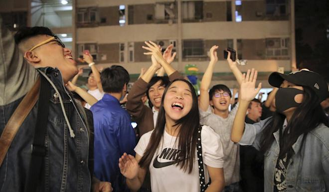 Opposition supporters celebrate the loss of firebrand pro-Beijing politician Junius Ho in November's District Council elections. Photo: AP