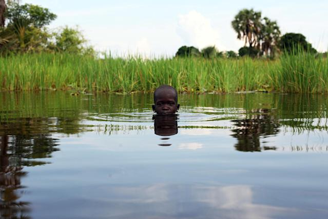 <p>A young girl plays in the Sudd Swamp near the town of Nyal, South Sudan, as the conflict continues between the government and opposition forces. (Reuters) </p>